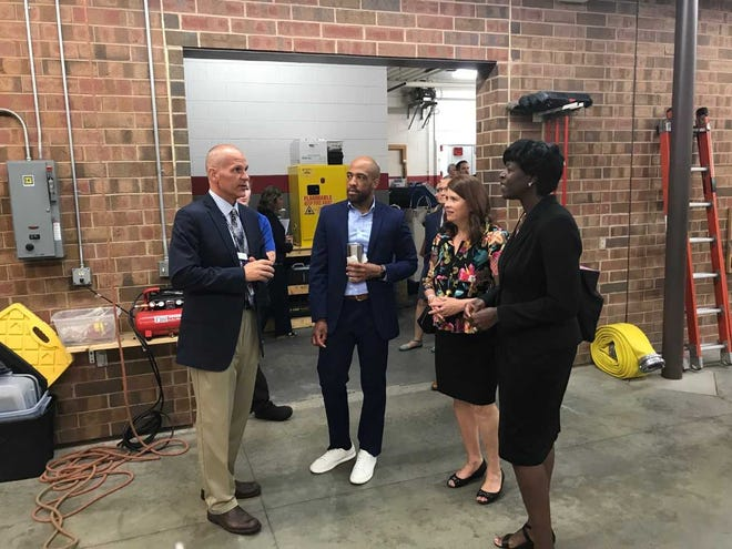 From left to right: Waukesha County Technical College Dean of the School of Protective & Human Services Greg West (left) speaks with Wisconsin Lieutenant Governor Mandela Barnes, Department of Financial Institutions (DFI) Secretary-Designee Kathy Blumenfeld, and Department of Safety and Professional Services (DSPS) Secretary-Designee Dawn B. Crim about the fire training program.