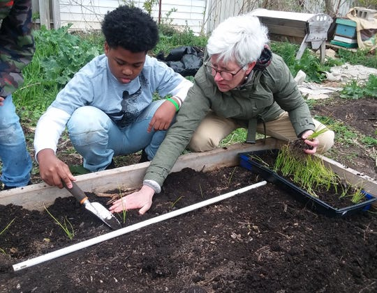 Ann Brummitt, executive director of the Victory Garden Initiative, worked with a young student in urban agriculture in 2019.