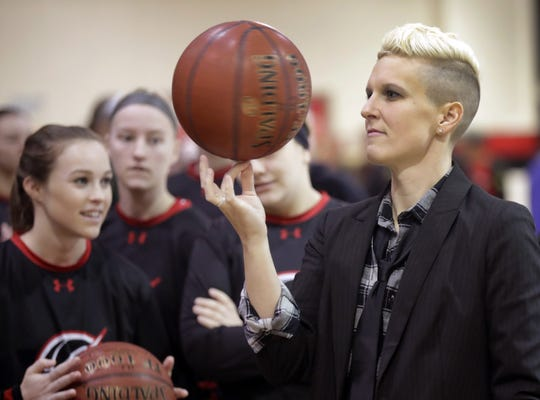 Seymour assistant coach Berri West spins a basketball before the team faces Beaver Dam during their WIAA Division 2 sectional final in 2017.