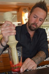 Bar manager Nick Proyce learned the basics of bartending from his mom at the Lake House Tap and Grill in Lake Geneva. He said he started experimenting with flavors and coming up with cocktails when he met Douglas Stringer, the owner of Hundred Mile House.