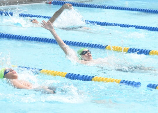 Mountain Home Hurricanes compete in the boys' 13-14 100-meter backstroke during a recent meet at Cooper Park.