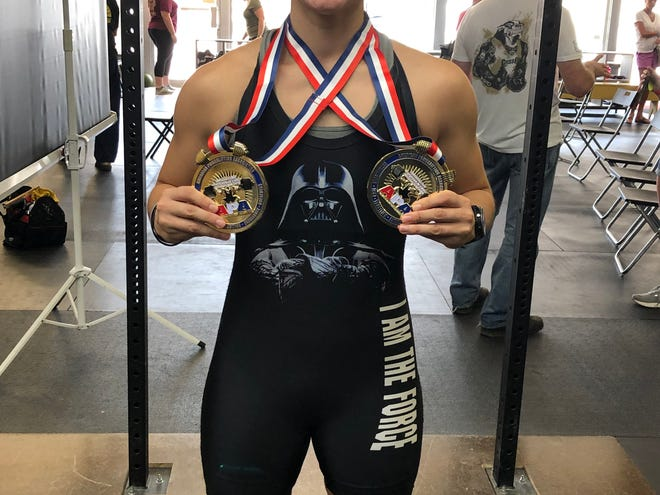 Marie Reed shows her medals after setting several state records, as well as two national records and a world record, at a recent powerlifting meet in Sikeston, Mo.