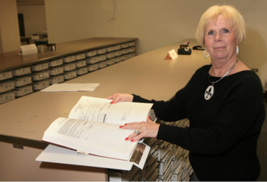 Ouachita Parish Clerk of Court Louise Bond stands beside records at the Clerk of Court's Office on March 13, 2013.