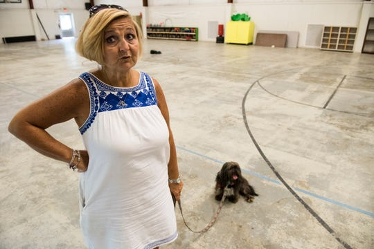 Rhonda Thompson with her dog, Brodie, at the Nehemiah Center in Montgomery, Ala., on Monday, July 1, 2019.