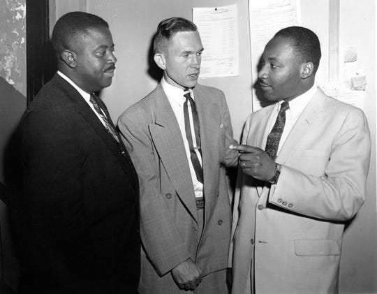 The Rev. Ralph D. Abernathy, the Rev. Robert S. Graetz, pastor of Trinity Luthern Church, and the Rev. Dr. Martin Luther King Jr., talk outside the witness room during the bombing trial in Montgomery on May 28, 1957.