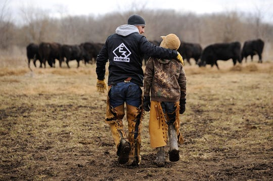 Adam LaRoche and son, Drake, at the E3 Ranch in Kansas.