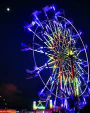 The Ferris wheel lights up the sky at the Sumner County Fair on July 11, 2019.