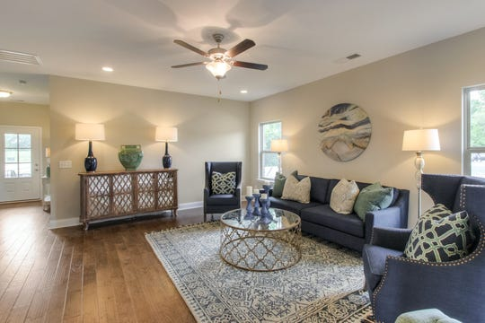 Interiors of Goodall's Monroe design are open and spacious. A model home is open in Carellton Cobblestone.