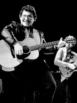 Russell Smith of the Amazing Rhythm Aces gives an energetic performance for the audience at the Municipal Auditorium Nov. 13, 1982.