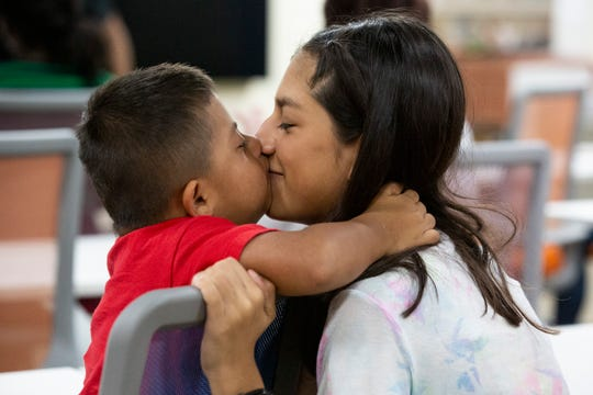 From right to left, Vivian Garcia, 16, Debbie Garcia's daughter, kisses her brother Jakob Garcia during a deployment celebration on Friday, July 12, 2019, at the Naples Accelerator in Naples. She is one of the eight female students who are going to the Naval Air Station in Pensacola at the end of the month.