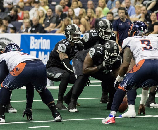 Newark's Grant Russell (12) takes a snap for the Columbus Destroyers Sunday in Nationwide Arena against the Albany Empire.