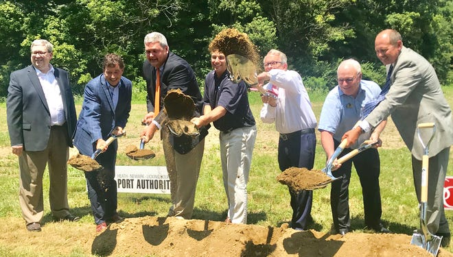 From left: Port Authority Executive President and CEO Rick Platt, Congressman Troy Balderson, State Rep. Scott Ryan, Heath Mayor Mark Johns, Gov. Mike DeWine, County Commissioner Rick Black, and State Sen. Jay Hottinger celebrate groundbreakings on two new spec buildings in Heath.
