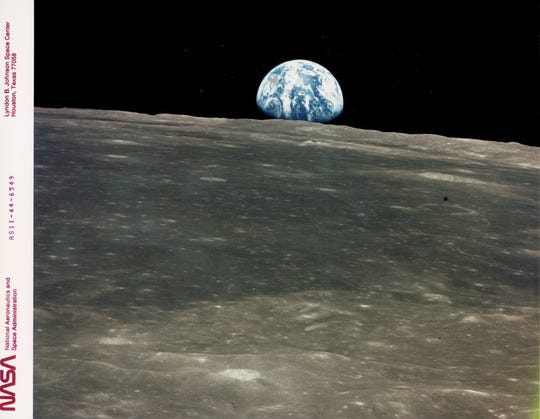 Earthrise on the moon, photographed by the Apollo 11 crew