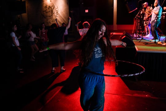 Amy Pinder hula-hoops during the Especially Everyone ensemble set at Debonair Music Hall in Teaneck on Sunday, July 14, 2019. Pinder is the co-founder of the Inclusion Festival, which offers a sensory-friendly music and wellness festival for people with special needs. Pinder and her co-founder Leah Barron (not pictured) hosted a sensory-supportive space at the concert for anyone feeling overwhelmed.
