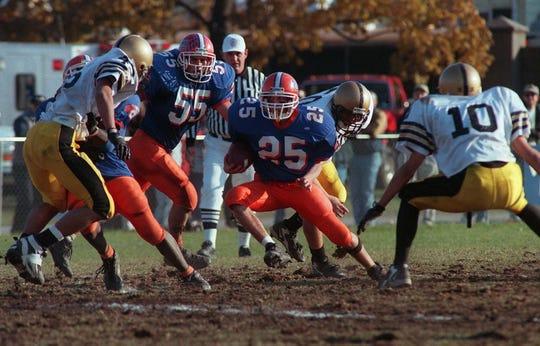 Lodi's Mark Maggio runs during a 1998 game.