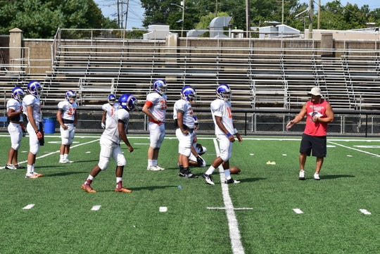 Mark Maggio works with players at Lodi practice in 2015.