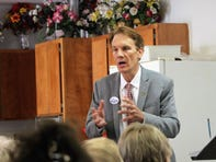 Love thy neighbor: Religion, politics intersect at congressional candidate's town hall