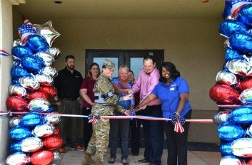 72nd Air Base Wing Command Chief Master Sergeant Melissa Erb cuts the ribbon on the grand opening of the Bldg. 5929 Micro Market at Tinker Air Force Base on June 18 with Services Manager Angela Gray, Imperial Vending Distributor Jeremy Willhite and General Manager Vanessa Roland.