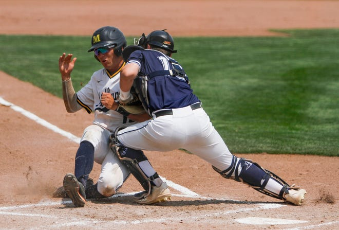 Dallas Tigers catcher Hudson Polk stops Midland Redskins Cal Conley from scoring a run during Game 13 of the Connie Mack World Series on Thursday, Aug. 9, 2018 at Ricketts Park in Farmington.