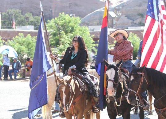 Delegate Charlaine Tso, left, was part of a group that rode horses in July 15 from the Navajo Nation fairground to the Navajo Nation Council chamber in Window Rock, Ariz.