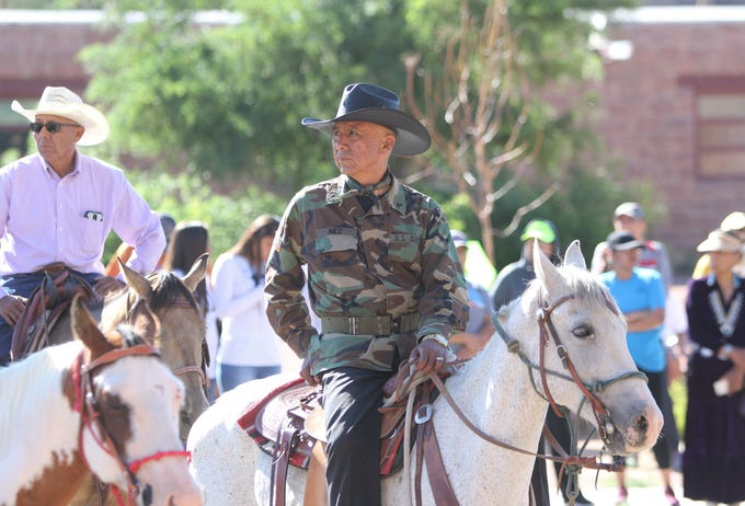 Delegate Rick Nez listens to comments during an event to welcome participants in the Navajo Nation Council summer session horse ride on July 15 in Window Rock, Ariz.