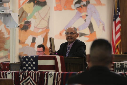 Delegate Nelson BeGaye shows his Bible while talking about his resignation from the Navajo Nation Council during the summer session on July 15 in Window Rock, Ariz.