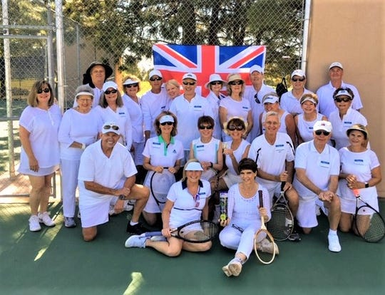 """Cheerio and pip-pip!"" Alto Lakes Tennis Association members clad in traditional Wimbledon white toast the All-England Tennis Championships at their second summer Grand Slam event, Breakfast at Wimbledon."