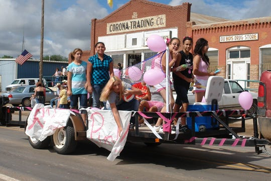A float full of happy young Corona students.