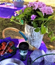 Wimbledon colors of purple and green decorated refreshment tables at Breakfast at Wimbledon, Alto Lakes Tennis Association's second summer Grand Slam event.