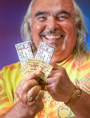 Pensacola resident John Pacitti shows off his original 1969 Woodstock tickets along with his tickets for this year's 50th anniversary event.