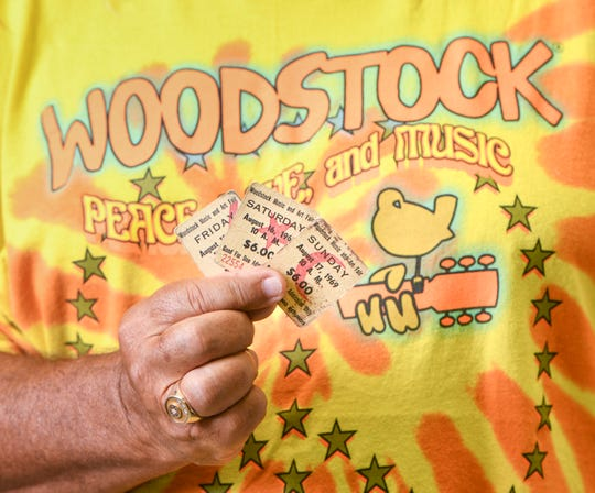 Pensacola resident John Pacitti shows off his original Woodstock tickets that he has held onto for the past 50 years since attending the historic event in August of 1969.