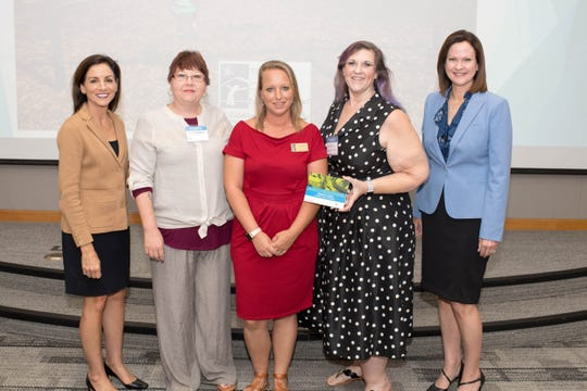 Children In Crisis receives $15,000 from the Gulf Power Foundation Amplify. Left to right: Marlene Santos, president, Gulf Power; Tammy Middleton, CIC; Laura Moore, CIC; Dr. Judy Manning, CIC; and Susan Melians, Gulf Power vice president of customer service, external relations.