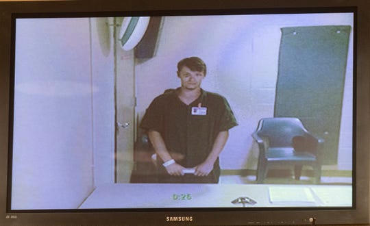 Jonathan Thomas Dixon makes his first appearance in court by video before Escambia County Judge Charles Young on Monday, July 15, 2019. In a video posted online of Dixon's arrest, an ECSO deputy can be seen punching him in the head several times during the arrest.