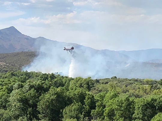 """Aerial support aided firefighters in suppressing the Horseshoe Fire on July 13"""