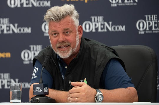 Darren Clarke speaks at a news conference during a practice round of The Open Championship at Royal Portrush Golf Club.