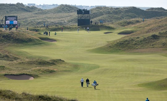 Golfers walk the on the Par 5, 7th fairway during a practice round of The Open Championship at Royal Portrush.