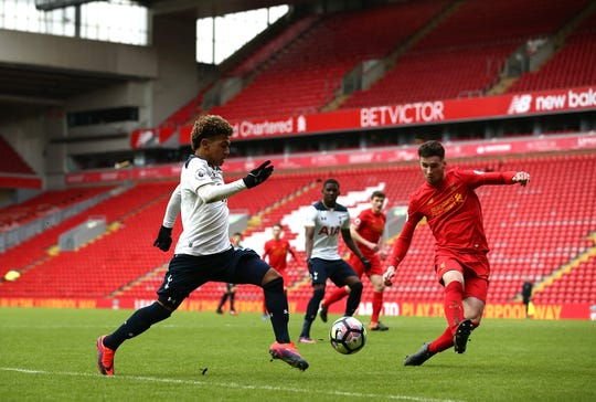 LIVERPOOL, ENGLAND - FEBRUARY 05:  Marcus Edwards of Tottenham Hotspur competes with Corey Whelan of Liverpool during the Premier League 2 match between Liverpool and Tottenham Hotspur at Anfield on February 5, 2017 in Liverpool, England.  (Photo by Jan Kruger/Getty Images)