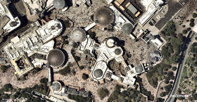 Crowds appear to be spread thin in this overhead of Star Wars: Galaxy's Edge at Disneyland. You can see the Millennium Falcon at the center top.