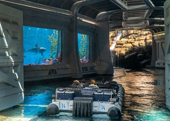 A boat rides through a virtual aquarium in Jurassic World - The Ride at Universal Studios Hollywood.