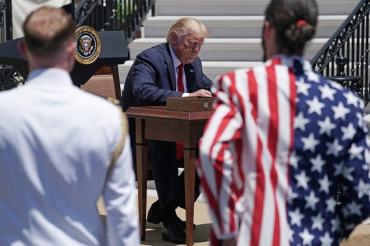 Trump al momento de firmar el decreto 'Made in America', el 15 de julio de 2019 en Washington, D.C.