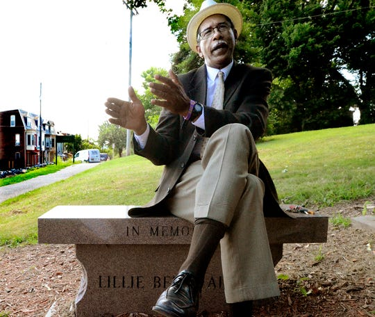 Sitting on the Lillie Belle Allen memorial bench at Farquhar Park, Eric Kirkland talks about racial tension in the York community Monday, July 15, 2019. He was shot by a white man in York City in 1968 when he was 15. Allen, a black woman from South Carolina, was killed nearby on Newberry Street during the 1969 riots in York. Bill Kalina photo