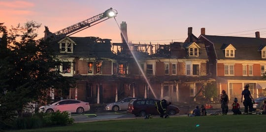 "Firefighters work to contain hot spots more than 3 1/2 hours after a fire damaged four homes on Boundary Avenue across from Fairmount Park in Red Lion. ""It is unfortunate for the residents,"" Leo Independent Fire Engine Co. No. 1 Fire Chief Joseph Silar said. ""They pretty much have lost pretty much everything in this fire."""