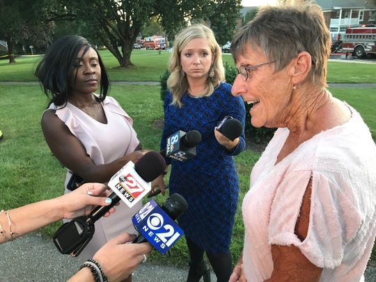 "Rita Mitcheom speaks with reporters on Sunday at Fairmount Park in Red Lion as firefighters continued to battle a two-alarm fire that severely damaged four homes and displaced 14 people on Boundary Avenue. ""They saved my house,"" Mitcheom said. ""I'm just overjoyed that I have a house."""