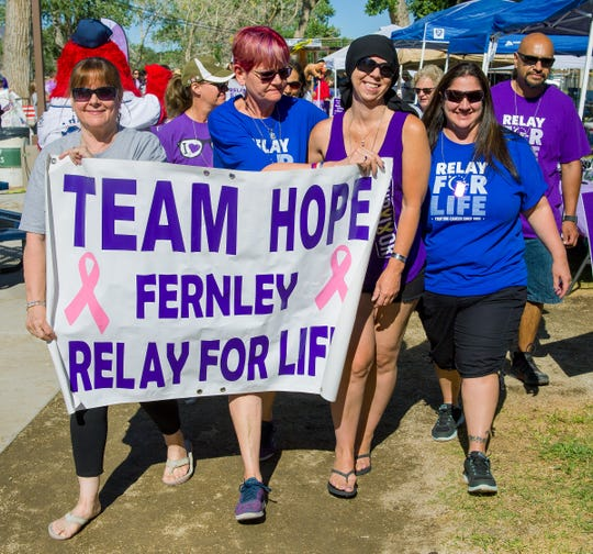 Team Hope begins their Relay for Life walk.