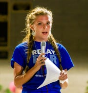 Alexis Hall reads a poem during the luminaria ceremony.