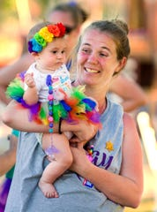 Savanna Miller, 5 months, and her mother Mindy MIller of Team Hope celebrate the completion of a lap.