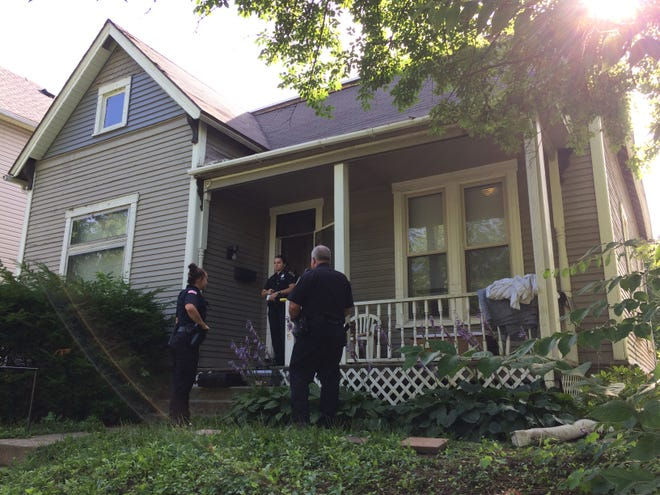 Richmond Police Department officers secure the scene Friday morning for the investigation into a shooting inside the South 15th Street residence.