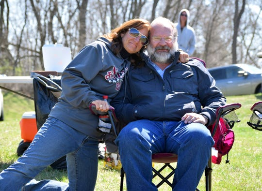 In this April, 2016 photo, Stacey Chaney and her brother Shane Del Grosso enjoy a moment together at a youth baseball game in Hagerstown, Md., shortly before Del Grosso committed suicide at age 50. Federal officials at the National Interagency Fire Center in Boise, Idaho, are bolstering mental health resources for wildland firefighters following an apparent increase in suicides.