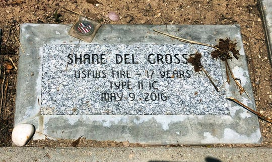 This June 3, 2019 photo shows a memorial stone for Shane Del Grosso at the Wildland Firefighters Monument at the National Interagency Fire Center in Boise, Idaho. Federal officials at the NIFC are bolstering mental health resources for wildland firefighters following an apparent increase in suicides.