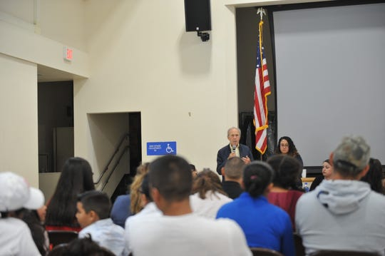 Attendees at Salinas' Jesse G. Sanchez Elementary School listen as Doug Keegan, an attorney and director of the Santa Cruz County Immigration Project, talks about their rights in light of President Donald Trump's announcement of federal immigration raids in major cities across the country on July 14, 2019.
